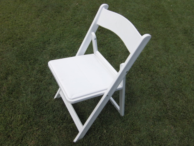 White padded resin folding chairs